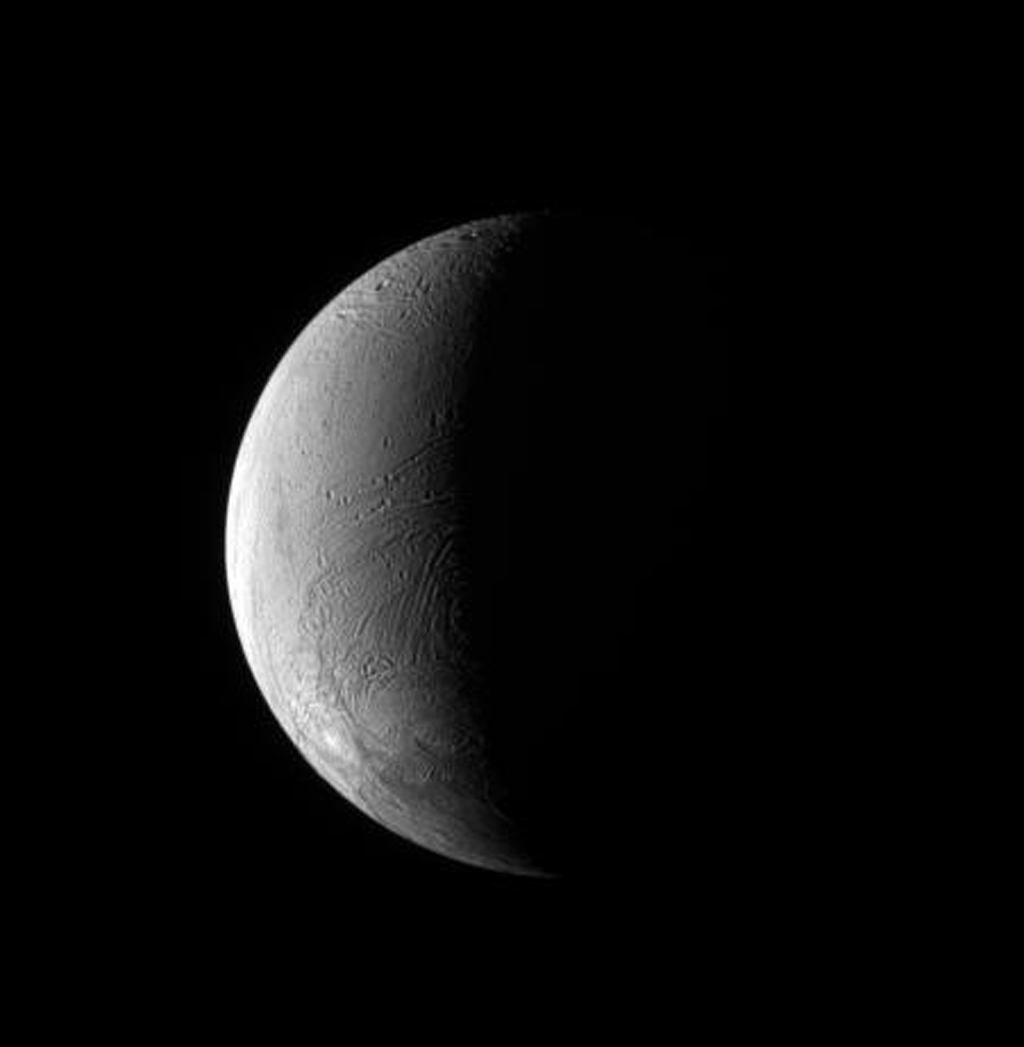NASA's Cassini spacecraft observes the wrinkled surface of Saturn's moon Enceladus. This view looks toward the Saturn-facing side of Enceladus (504 kilometers, or 313 miles across).