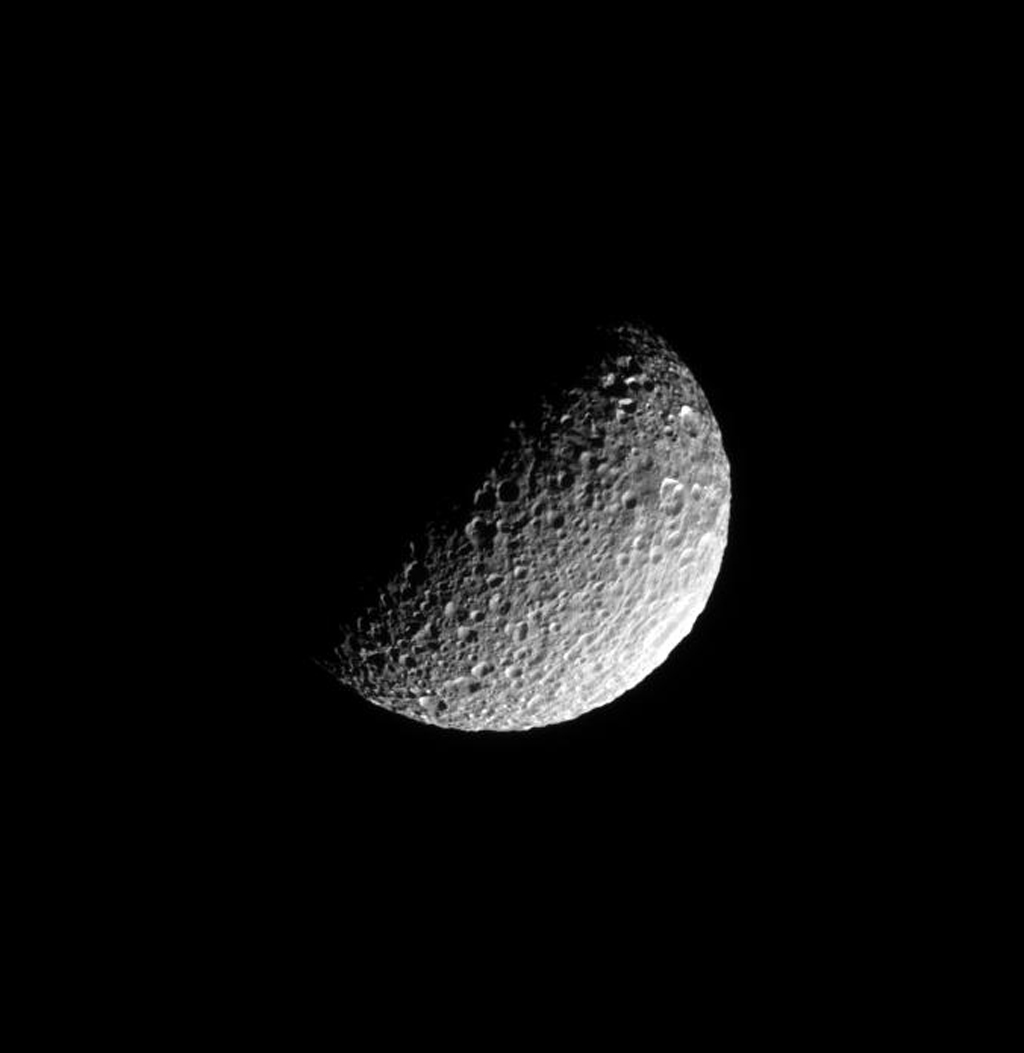 Deep craters riddle the pulverized, icy surface of Saturn's moon Mimas in this image captured by NASA's Cassini spacecraft on June 16, 2008.