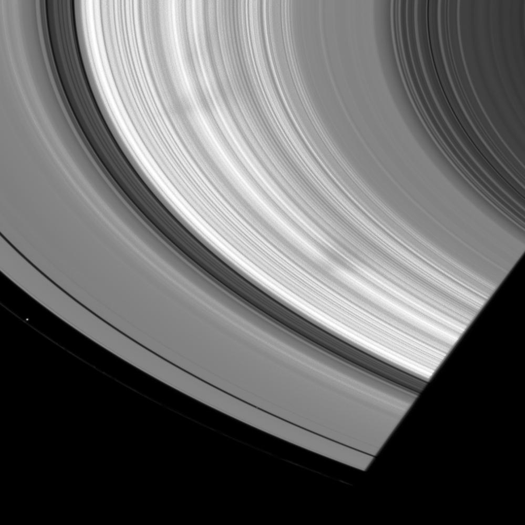 NASA's Cassini spacecraft spots a couple of large, wedge-shaped spokes in Saturn's B ring in this image from July 8, 2008.