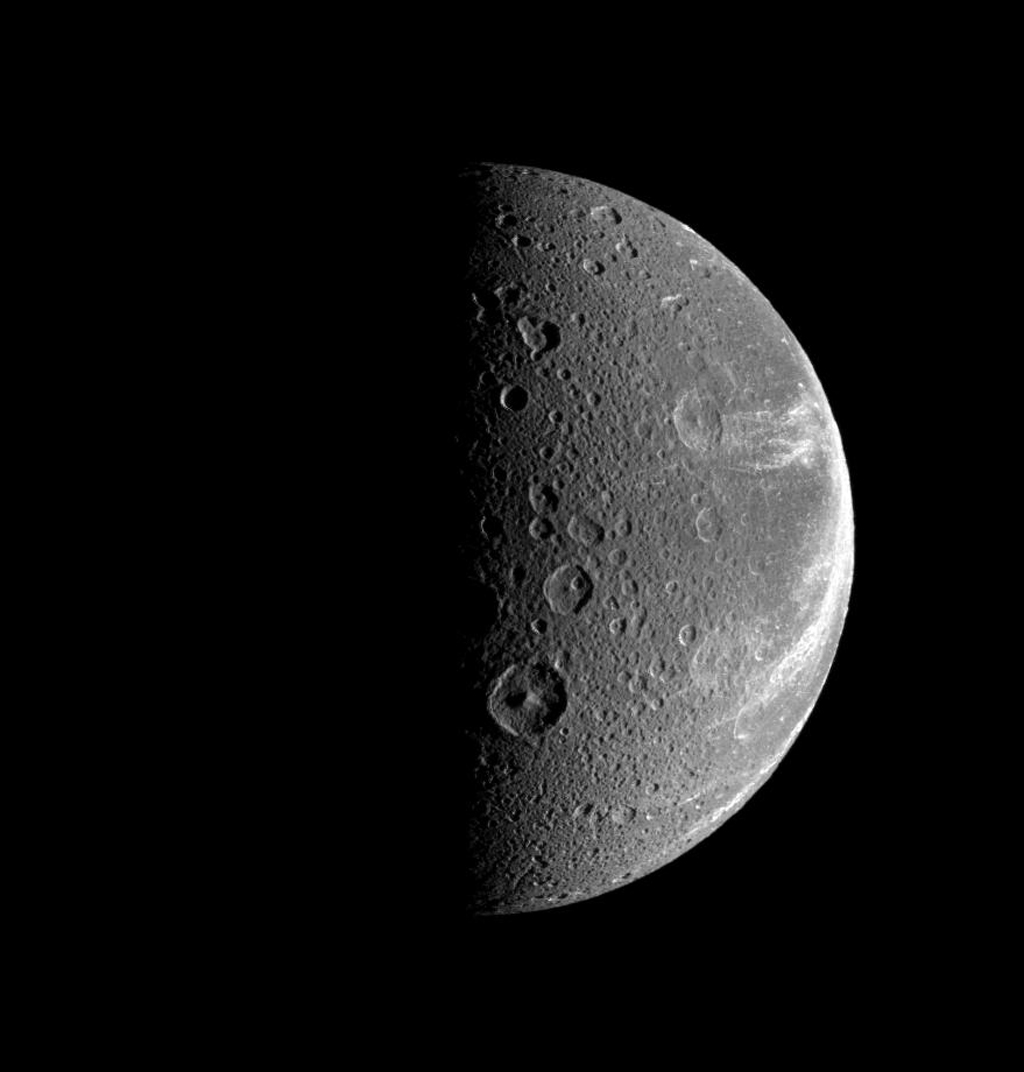 Bright, wispy-looking fractures reach across the rugged, icy landscape of Saturn's moon, Dione. This image was taken in visible light with NASA's Cassini spacecraft's narrow-angle camera on July 21, 2008.