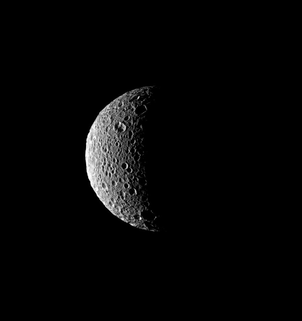 The sun's low angle near the terminator throws the craters of Saturn's moon, Mimas, into stark relief in this image was captured by NASA's Cassini spacecraft on Aug. 4, 2008.