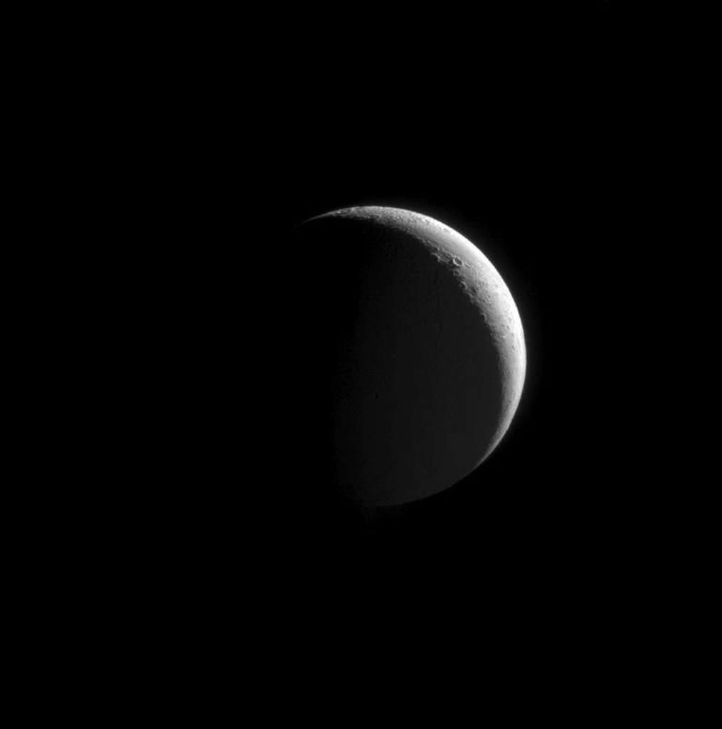 Northern craters line the crescent of Enceladus. This image from NASA's Cassini spacecraft is part of an observation designed to view the moon's plume of icy particles at a moderately high phase angle.