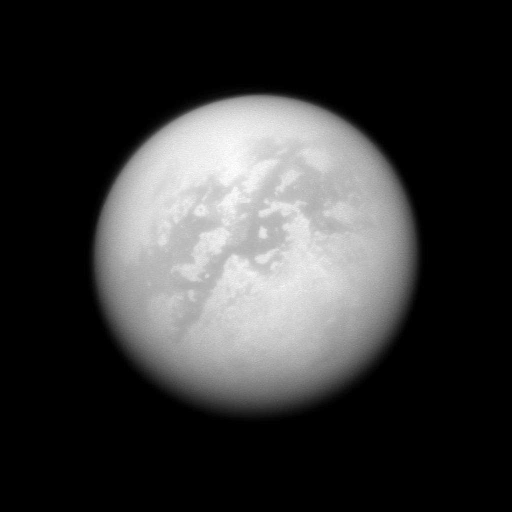 NASA's Cassini spacecraft peeks through the murk of Titan's thick atmosphere in a search for clouds. Although there are no obvious cloud features in this view, bright cloud streaks have occasionally been seen by Cassini and Earth-based telescopes.