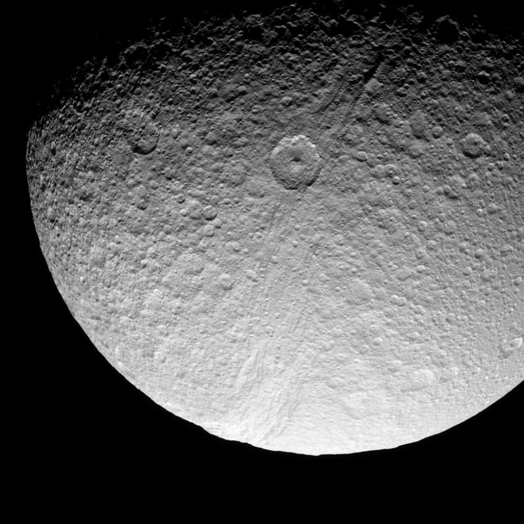 The prominent crater Telemachus sits within the northern reaches of Ithaca Chasma on Saturn's moon Tethys in this image captured by NASA's Cassini spacecraft on Sept. 24, 2008.