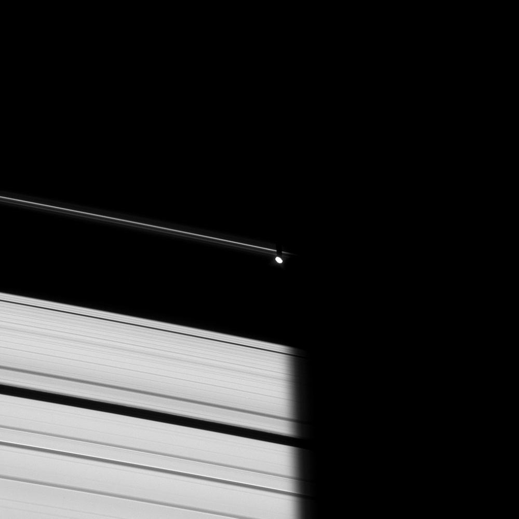 Prometheus emerges from Saturn's shadow in this image taken on Oct. 29, 2008 by NASA's Cassini spacecraft of the dark side of the rings.