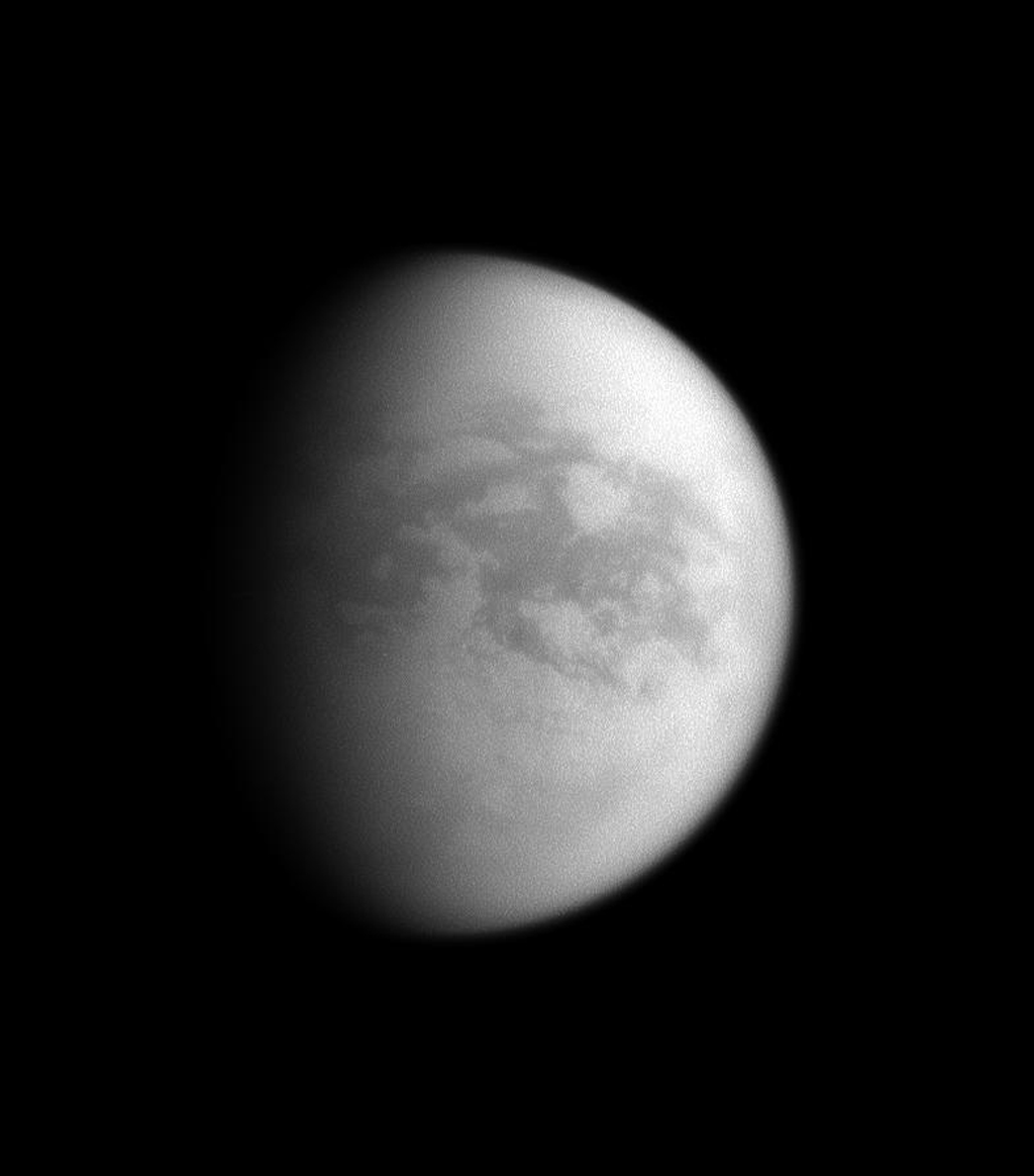Although this image is centered on the Saturn-facing hemisphere of Titan, here the sun illuminates mainly the trailing hemisphere of Saturn's largest moon. This image was taken by NASA's Cassini spacecraft's narrow-angle camera on Nov. 9, 2008.