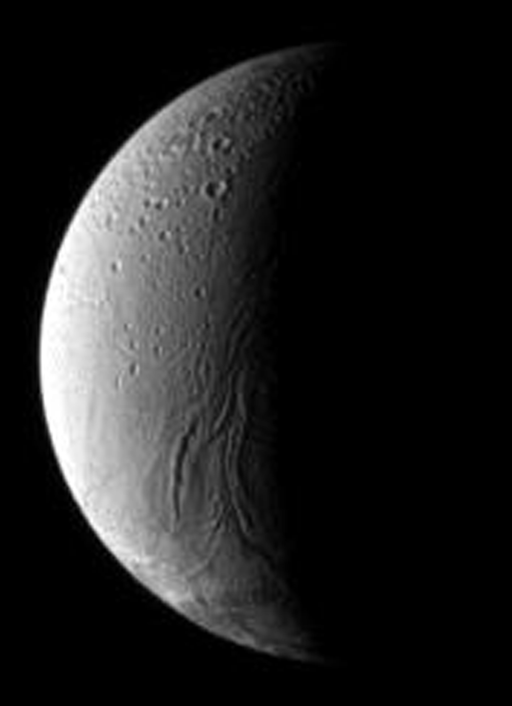 In the boundary between light and shadow on Saturn's moon Enceladus, run the Anbar Fossae, a series of narrow, shallow depressions. This image was taken by NASA's Cassini spacecraft's narrow-angle camera on Dec. 17, 2008.