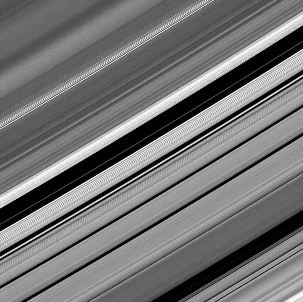 Dark straw-like patterns dot Saturn's bright outer B ring just left of the Huygens Gap in the center of this image taken by NASA's Cassini spacecraft on Dec. 8, 2008.