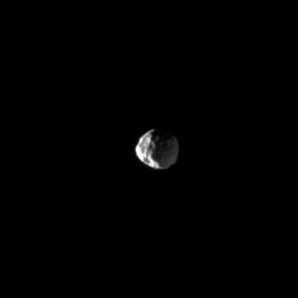 NASA's Cassini spacecraft looks down on the cratered northern leading hemisphere of Dione, showing the moon's pockmarked surface in this image taken on June 11, 2009.