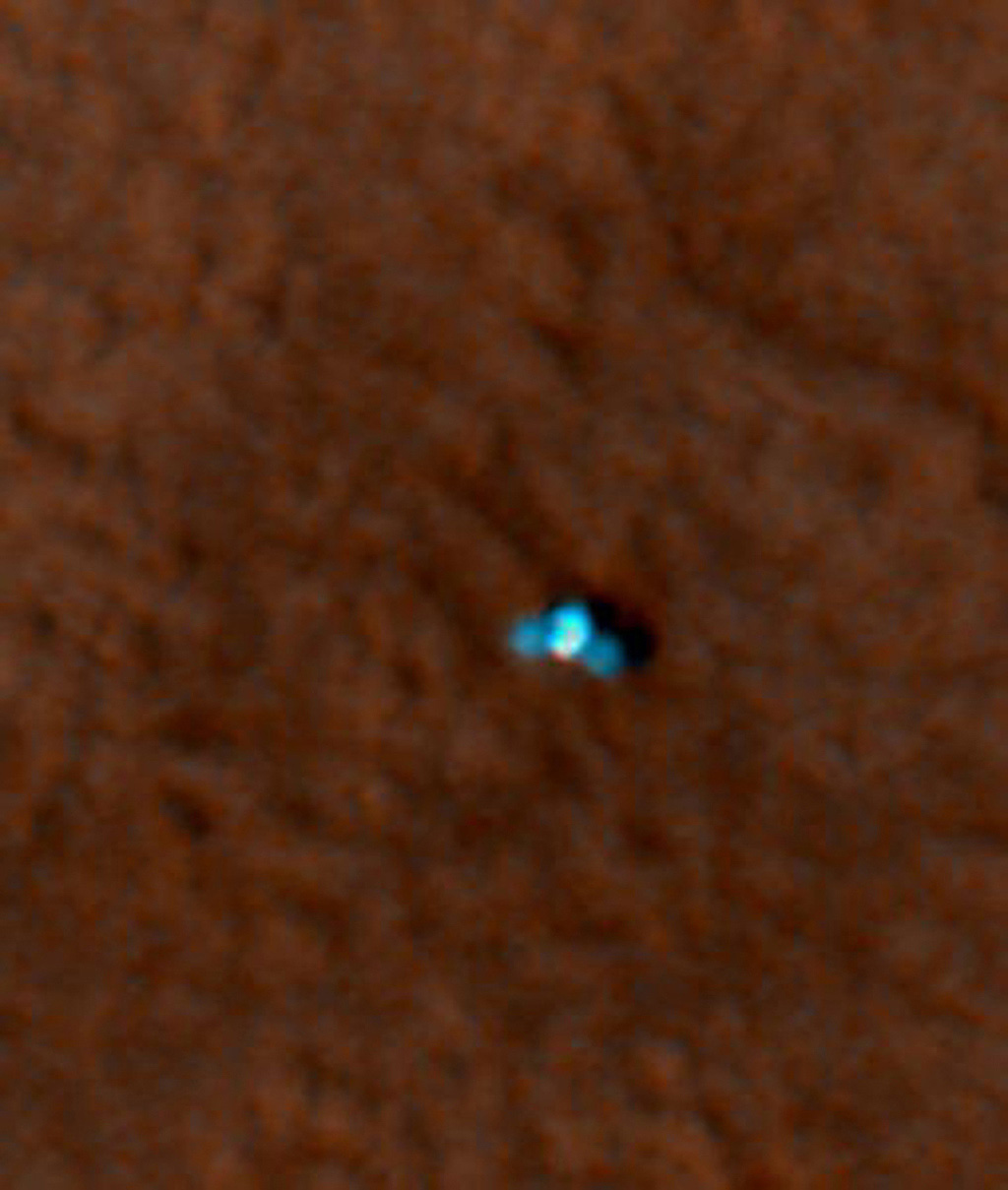 This is an enhanced-color image from Mars Reconnaissance Orbiter's High Resolution Imaging Science Experiment (HiRISE) camera. It shows the NASA's Mars Phoenix lander with its solar panels deployed on the Mars surface
