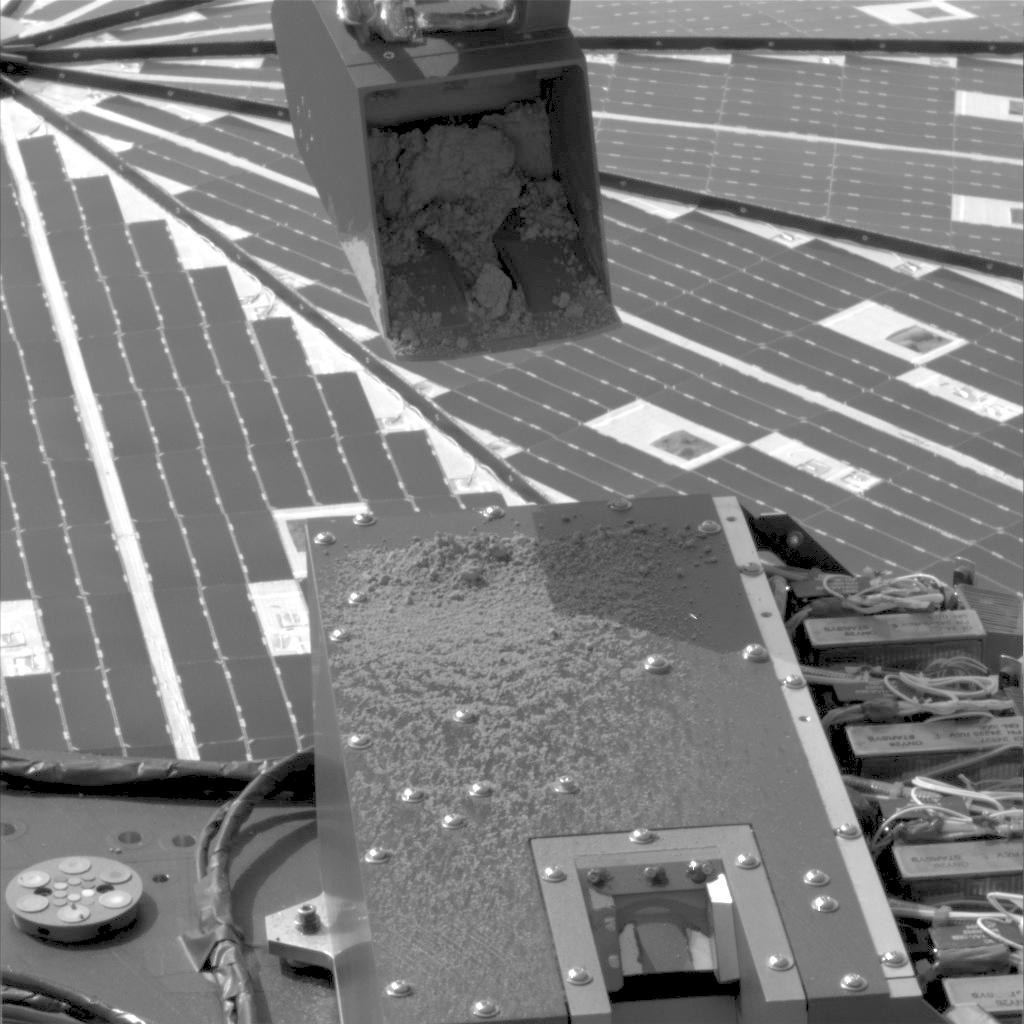 NASA's Phoenix Mars Lander used its Robotic Arm during the mission's 15th Martian day since landing (June 9, 2008) to test a 'sprinkle' method for delivering small samples of soil to instruments on the lander deck.