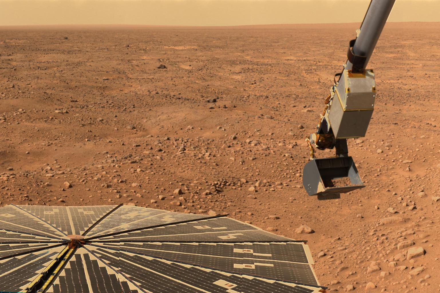 This panorama image of NASA's Phoenix Mars Lander's solar panel and the lander's Robotic Arm with a sample in the scoop. The image was taken just before the sample was delivered to the Optical Microscope.