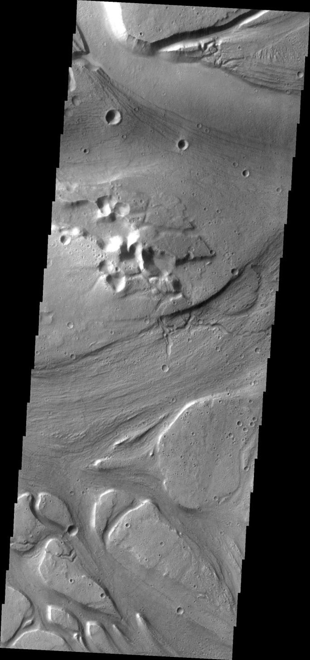 This image from NASA's Mars Odyssey shows a complex region of channels, part of Kasei Valles, one of the large outflow channels on Mars.