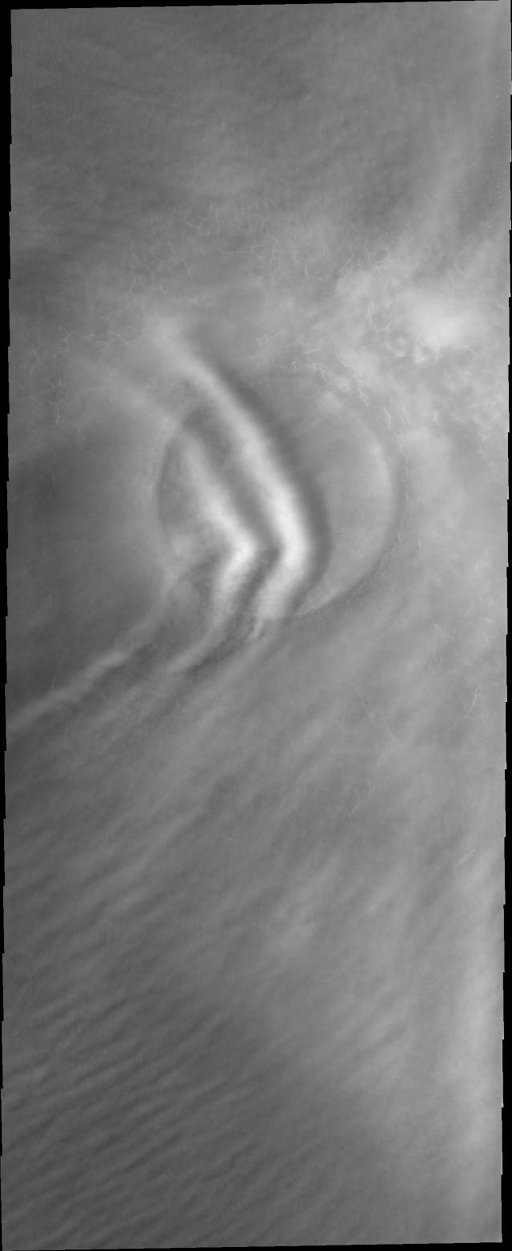 This image from NASA's Mars Odyssey shows clouds close enough to the martian surface to be affected by this crater.