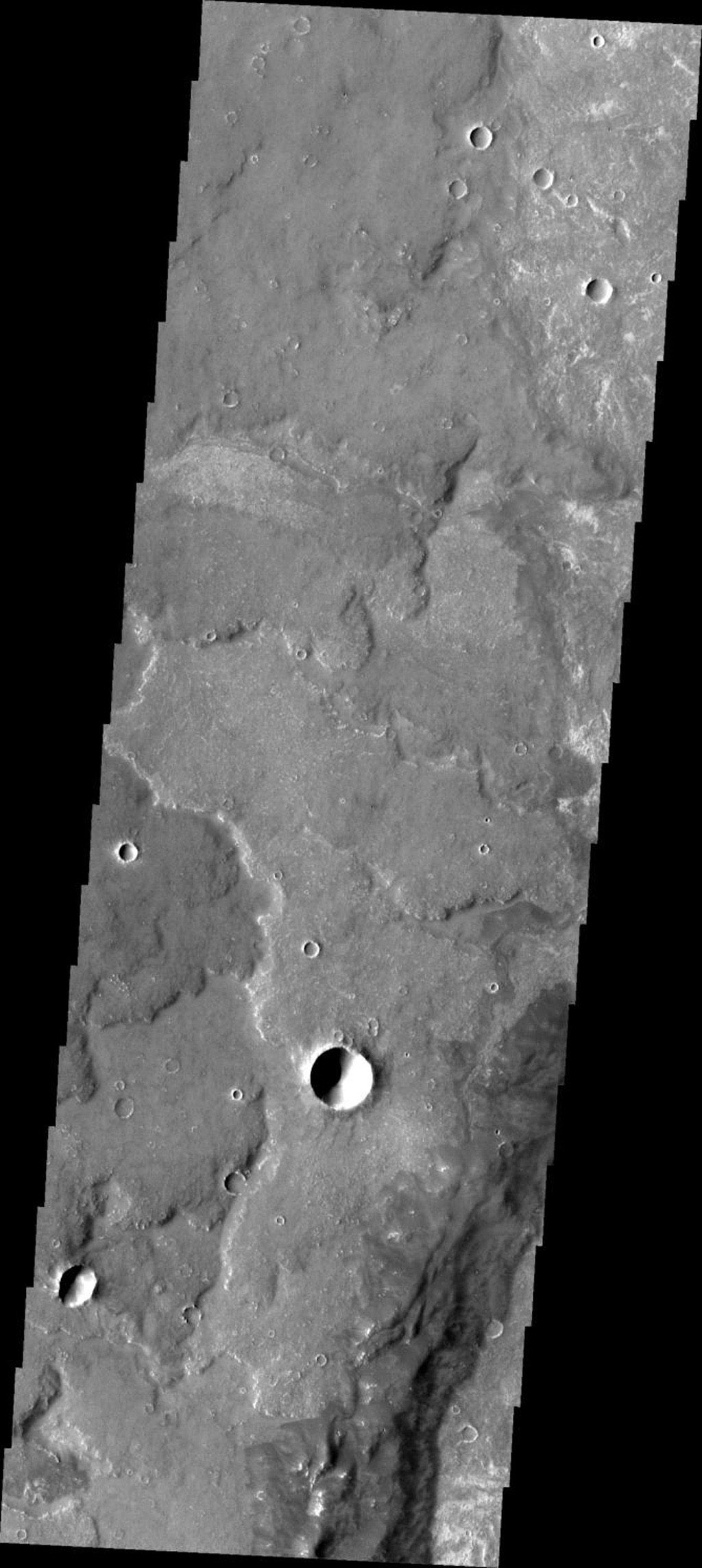 This image from NASA's Mars Odyssey shows some of the extensive lava flows that make up Syria Planum on Mars.