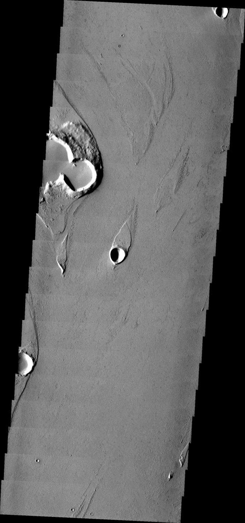 This image from NASA's Mars Odyssey shows Marte Vallis, a large, complex lava channel on Mars. The lava is able to create features, such as streamlined islands, that are more commonly seen in water carved channels.