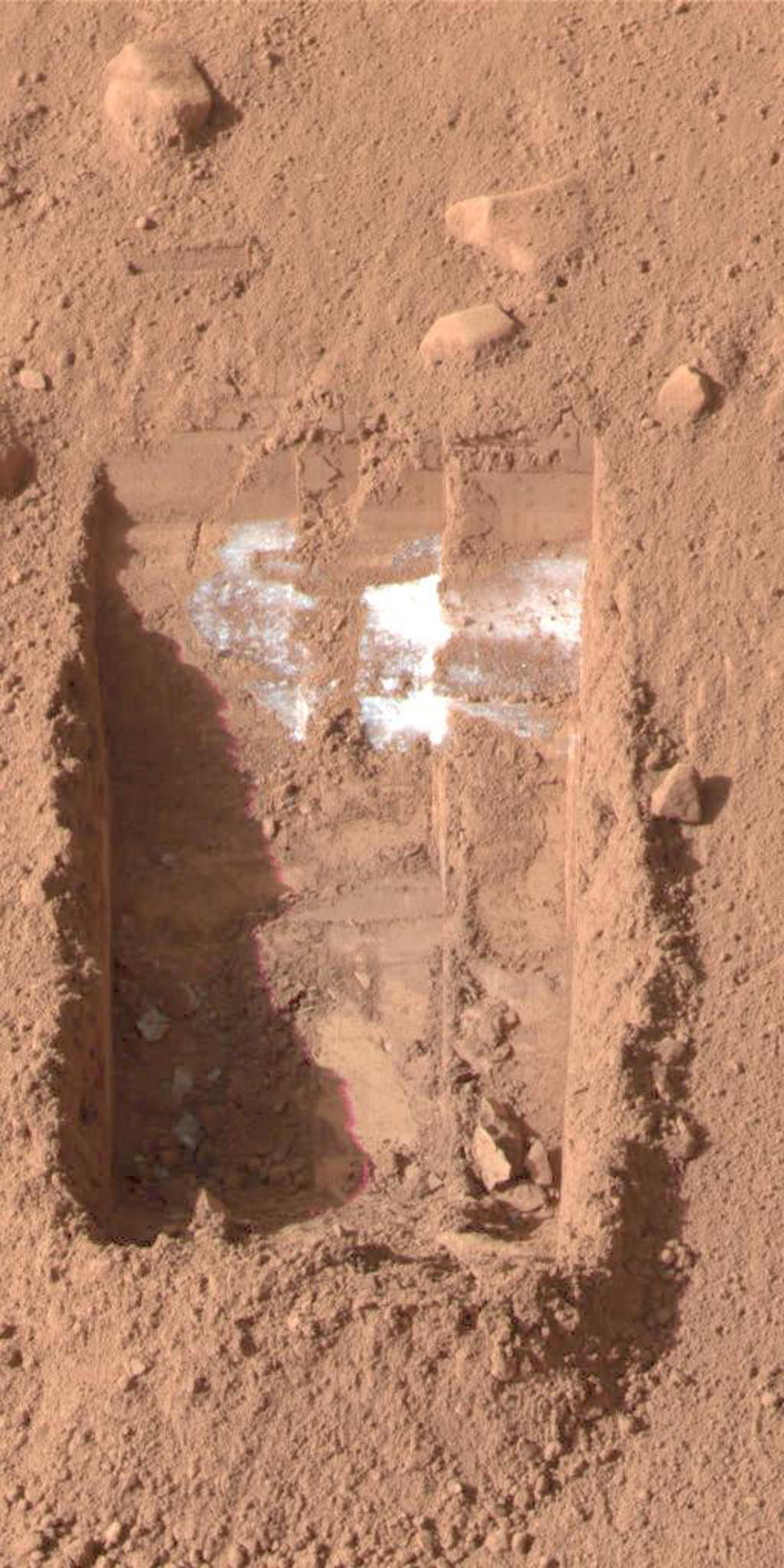 This color image was acquired by the Surface Stereo Imager on NASA's Phoenix Mars Lander on the 21st day of the mission, or Sol 20 (June 15, 2008). It shows lumps of ice in the lower left corner of a trench nicknamed 'Dodo-Goldilocks.'