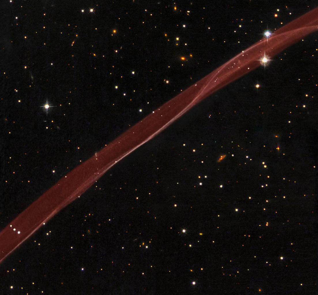 A delicate ribbon of gas floats eerily in our galaxy. This image, taken by NASA's Hubble Space Telescope, is a very thin section of a supernova remnant caused by a stellar explosion that occurred more than 1,000 years ago.