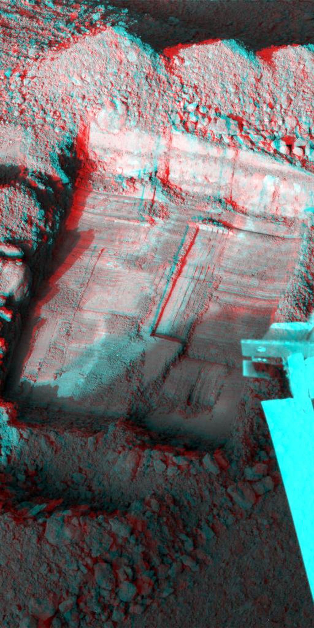 This anaglyph, acquired by NASA's Phoenix Lander shows a stereoscopic 3D view of a trench informally called 'Snow White' dug by Phoenix's Robotic Arm. 3D glasses are necessary to view this image.