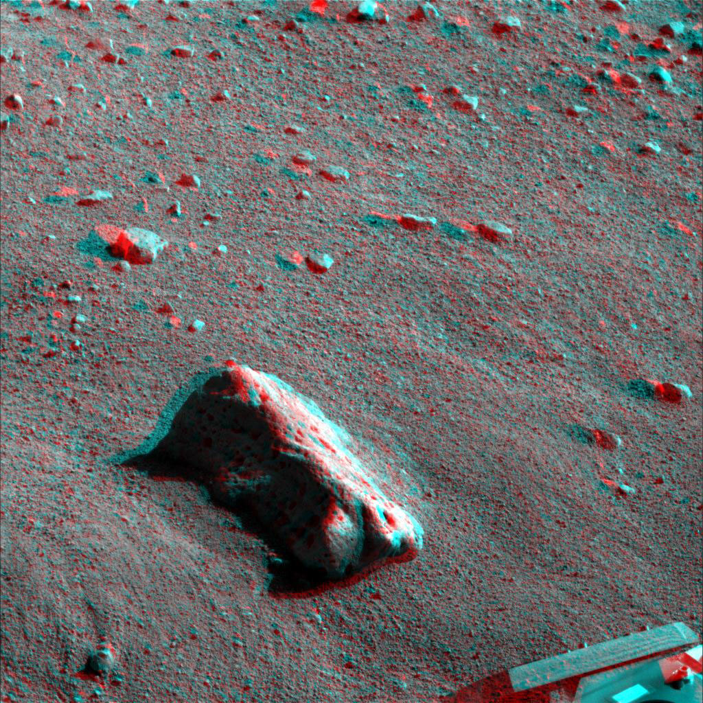 This anaglyph, acquired by NASA's Phoenix Lander on Jun. 15, 2008, shows the largest rock informally called 'Midgard.' 3D glasses are necessary to view this image.