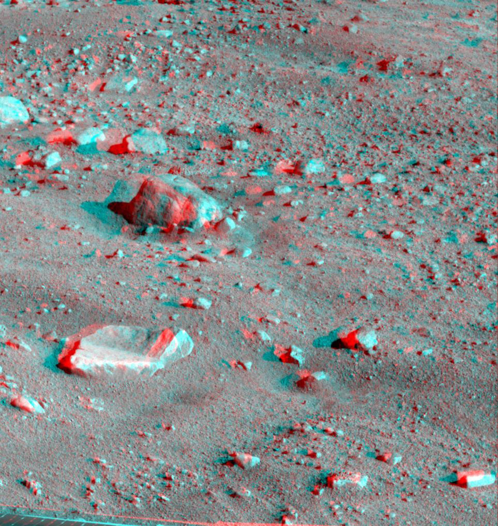 This anaglyph, acquired by NASA's Phoenix Lander on Jun. 10, 2008, shows a large rock called 'Winkies.' 3D glasses are necessary to view this image.