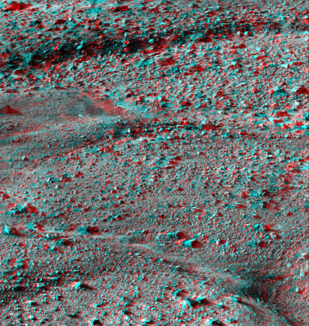 This anaglyph, acquired by NASA's Phoenix Lander's Surface Stereo Imager on June 8, 2008, shows a stereoscopic 3D view of the Martian surface near the lander. 3D glasses are necessary.