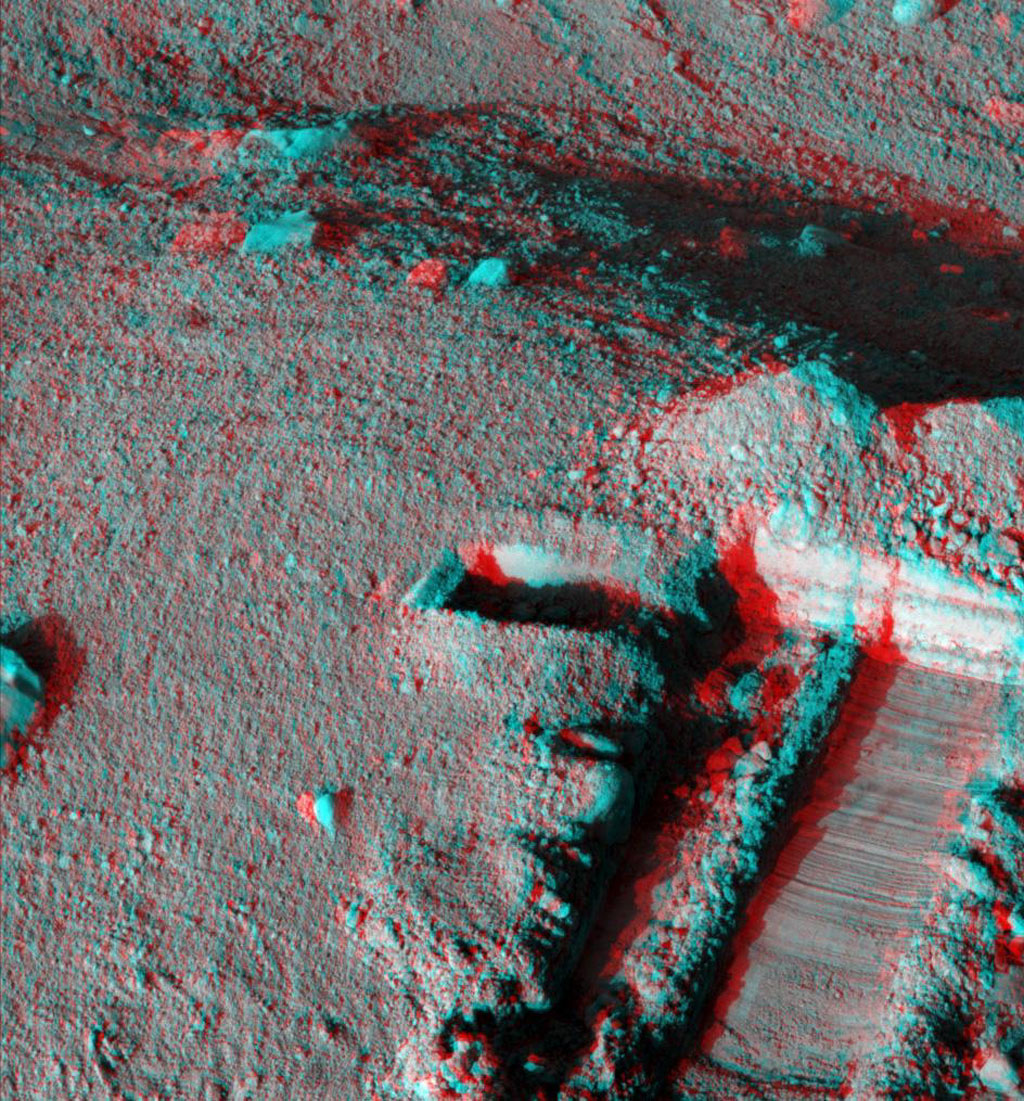This anaglyph, acquired by NASA's Phoenix Lander on Jun. 19, 2008, shows a stereoscopic 3D view of the Martian surface near the lander. 3D glasses are necessary to view this image.