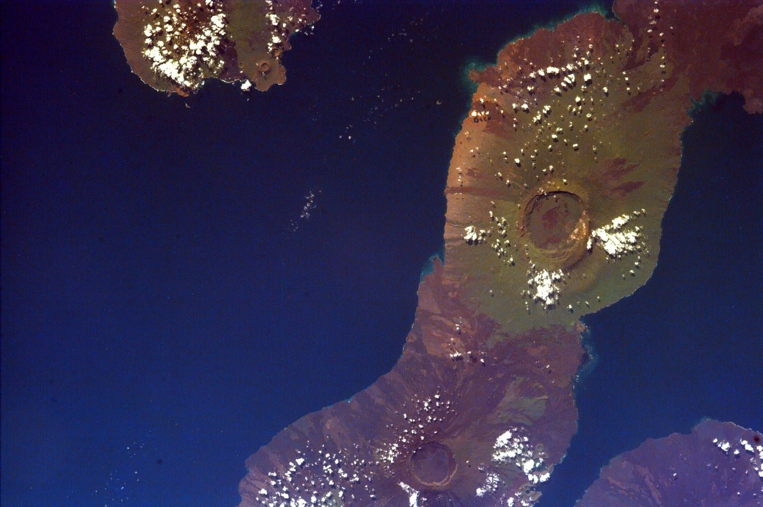 This image of the Galapagos Islands captures two large shield volcanoes on Isla Isabella, the largest and least inhabited island in the Galapagos chain. This image is from NASA's EarthKAM..