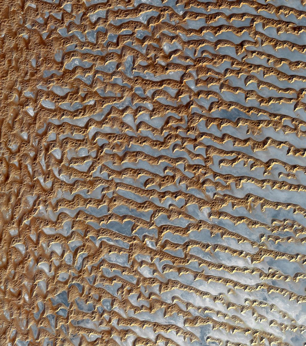 NASA's Terra spacecraft shows the Rub' al Khali, one of the largest sand deserts in the world, encompassing most of the southern third of the Arabian Peninsula; it includes parts of Oman, United Arab Emirates, and Yemen.
