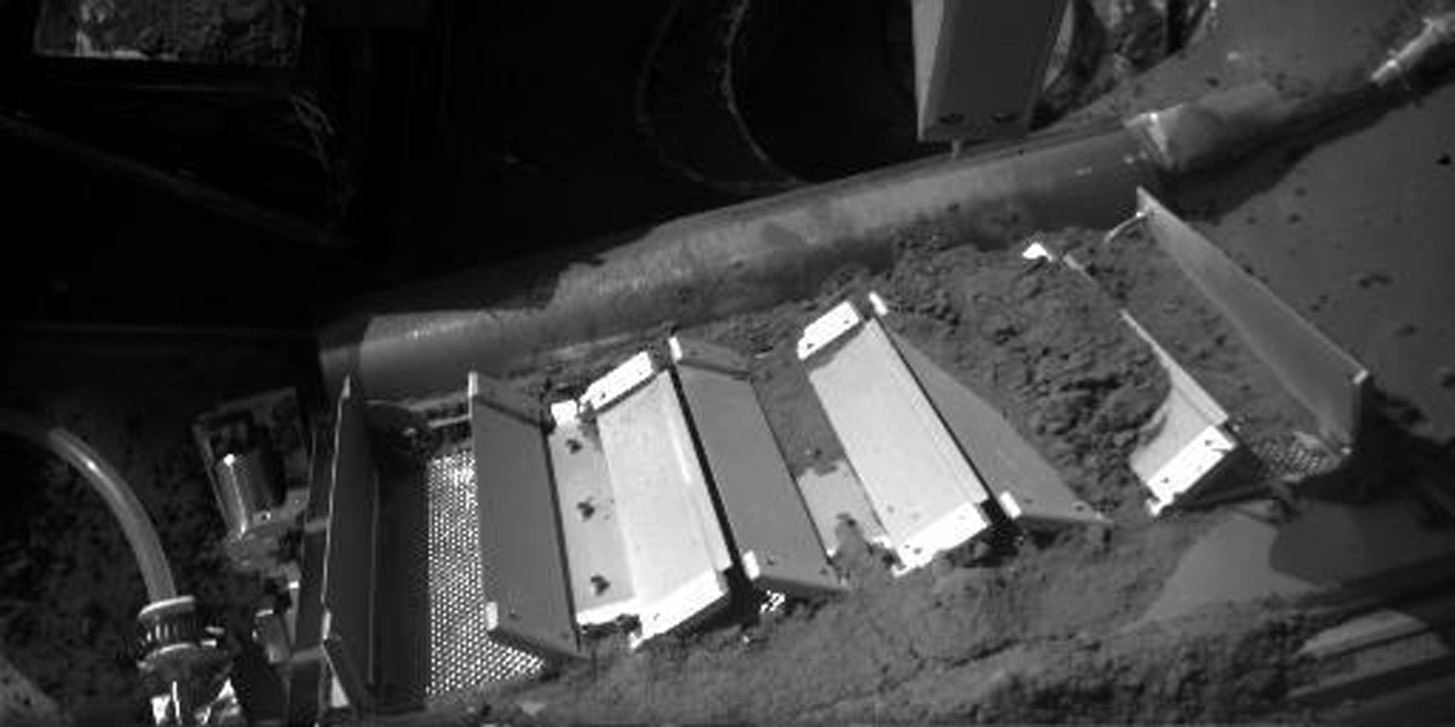 This image shows soil on the doors of the Thermal and Evolved Gas Analyzer (TEGA) onboard NASA's Phoenix Mars Lander. The image was taken by the lander on Oct. 7, 2008. This sample delivered to TEGA was named 'Rosy Red.'