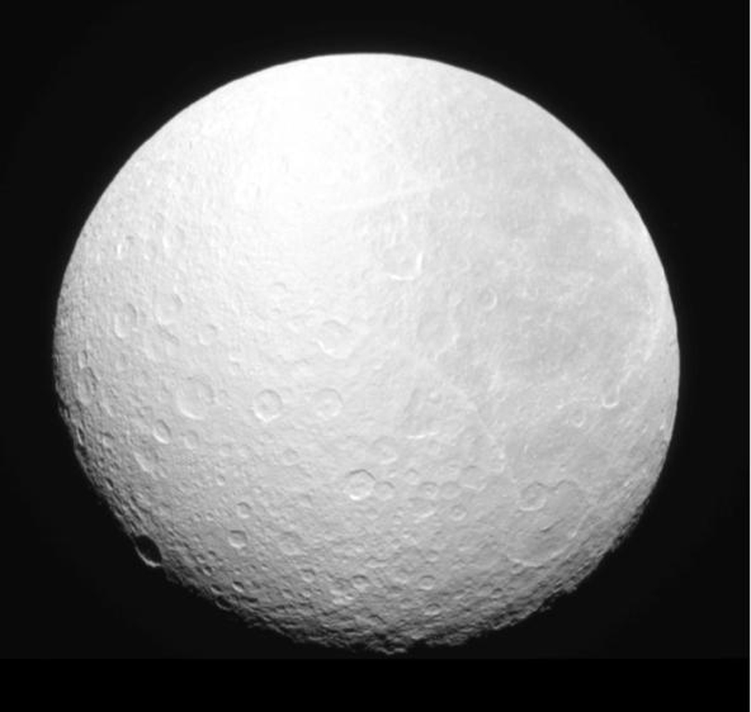 NASA's Cassini spacecraft's narrow-angle camera captured Saturn's moon Rhea as it gradually slipped into the planet's shadow, an event known as 'ingress,' on Aug. 19, 2008.