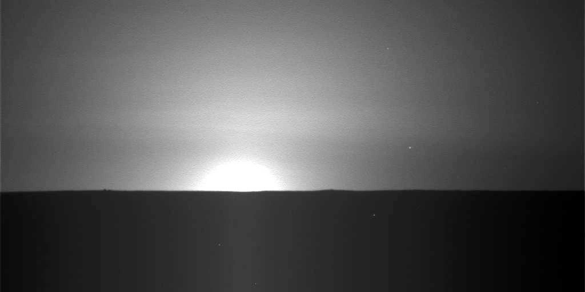 This frame from a sequence of nine images taken by the Surface Stereo Imager on NASA's Phoenix Mars Lander shows the sun rising on the morning of the lander's 101st Martian day after landing.