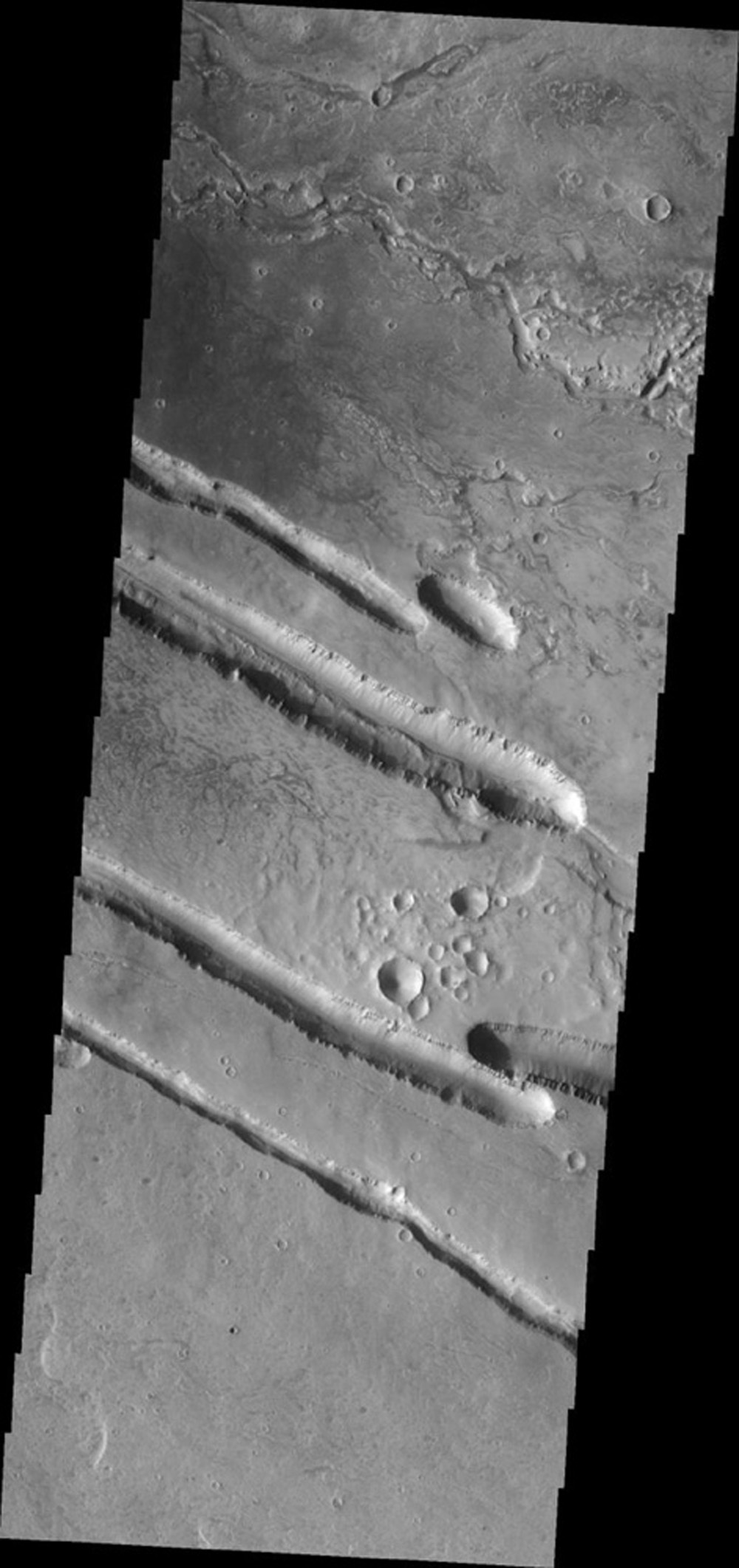 This image from NASA's Mars Odyssey shows fracturing and collapse related to the Elysium Volcanic Complex on Mars.
