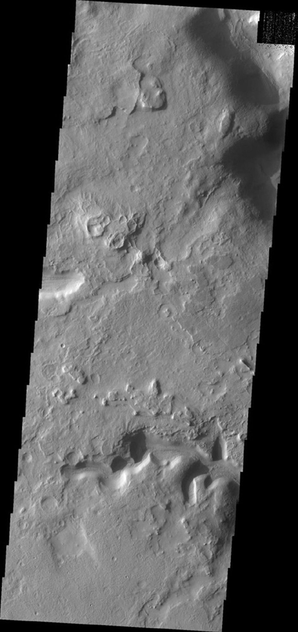 This image from NASA's Mars Odyssey shows channels located on the eastern and northern margins of Terra Sabaea on Mars. Dunes are located on the floor of the channel.