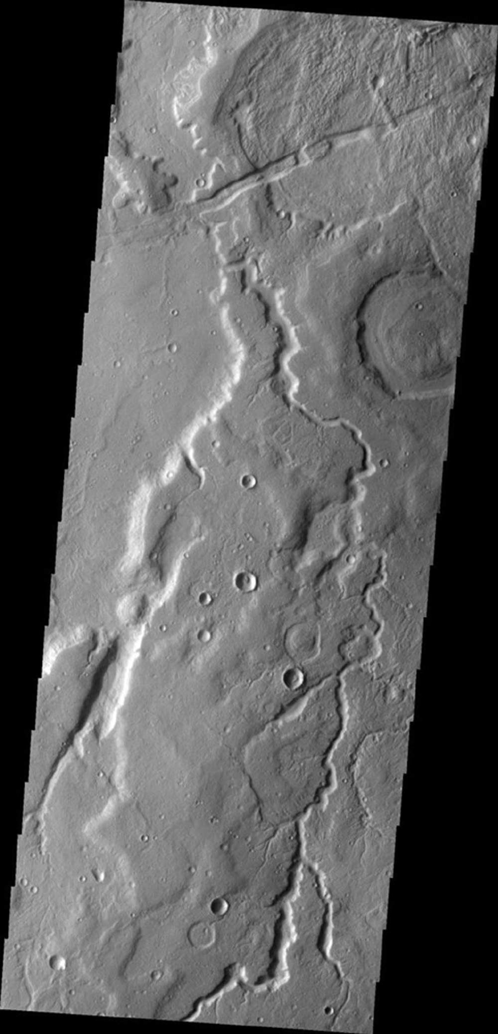 This image from NASA's Mars Odyssey shows an unnamed channel on Mars located on the eastern margin of Tempe Terra.