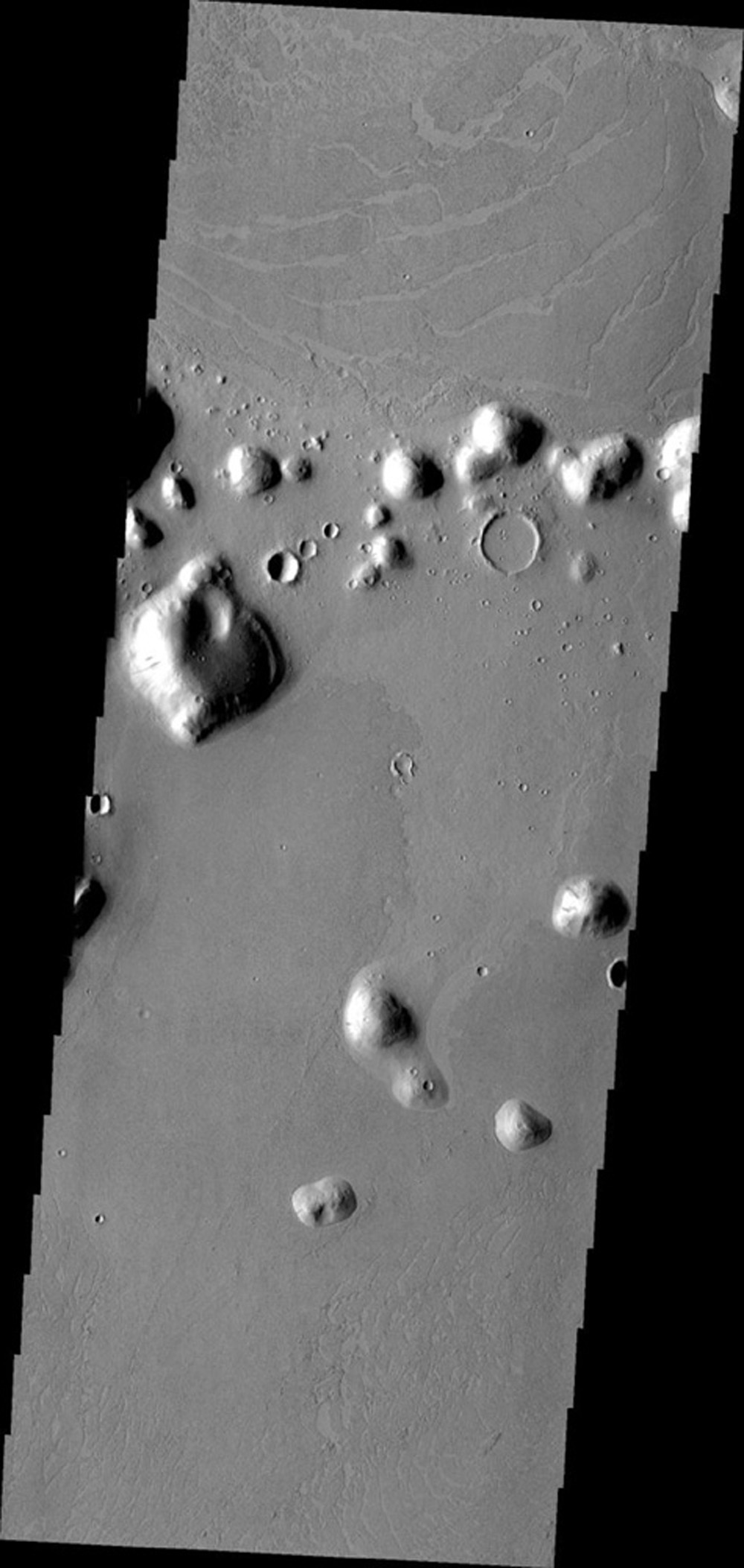 This image from NASA's Mars Odyssey shows Marte Vallis, a large volcanic complex on Mars. Platy flows, where the top crust has cooled and then cracked and moved due to molten lava below, are typical of this volcanic complex.