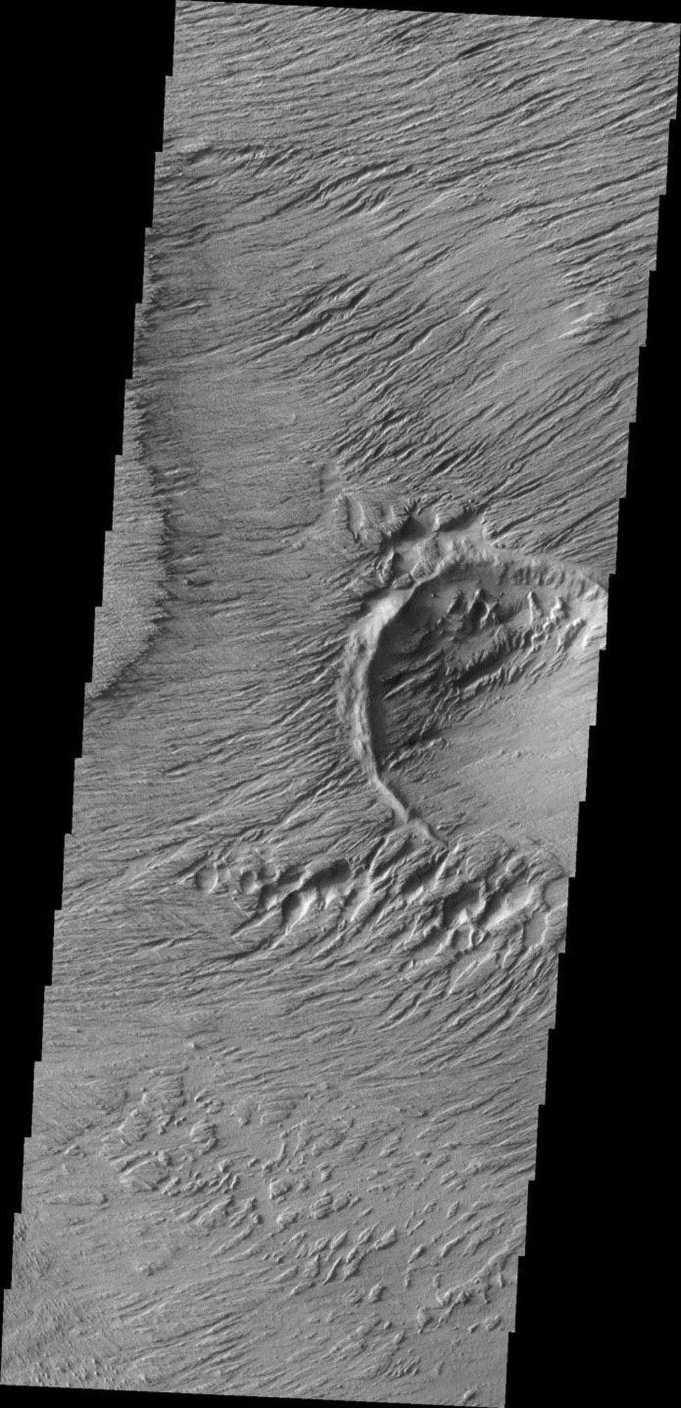 This image from NASA's Mars Odyssey shows a region of extensive erosion by the wind on Mars.