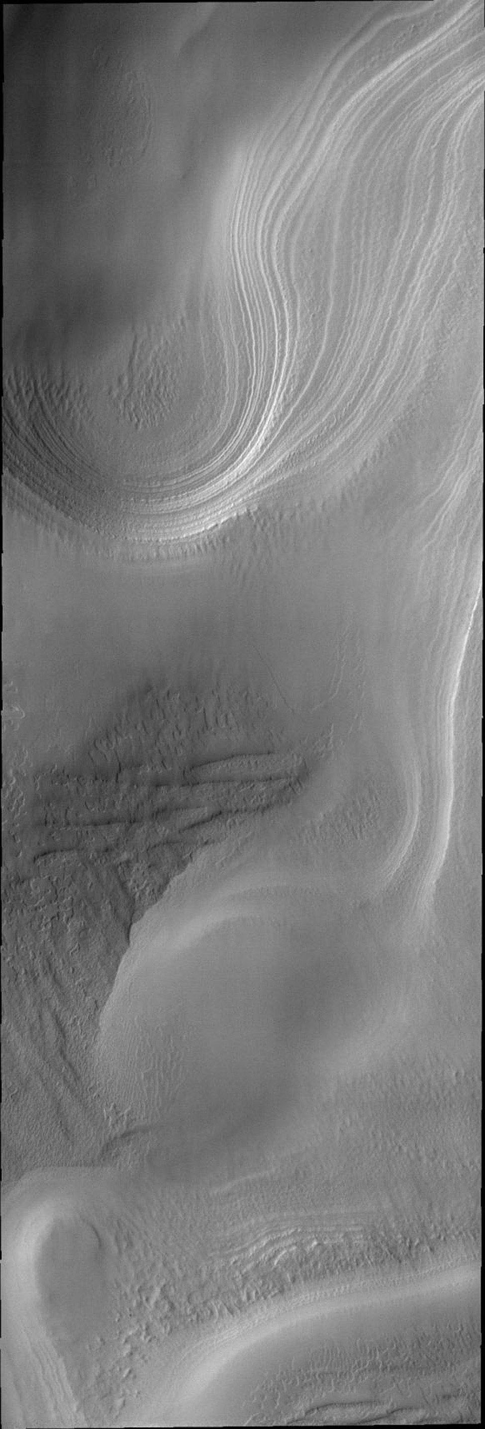 This image from NASA's Mars Odyssey shows beautiful swirling layers and surface textures at the south pole of Mars.