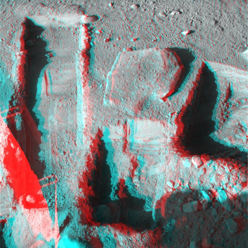 The Surface Stereo Imager on NASA's Phoenix Mars Lander took this anaglyph on Oct. 21, 2008; the trench on the upper left is called 'Upper Cupboard.' 3-D glasses are necessary to view this image.
