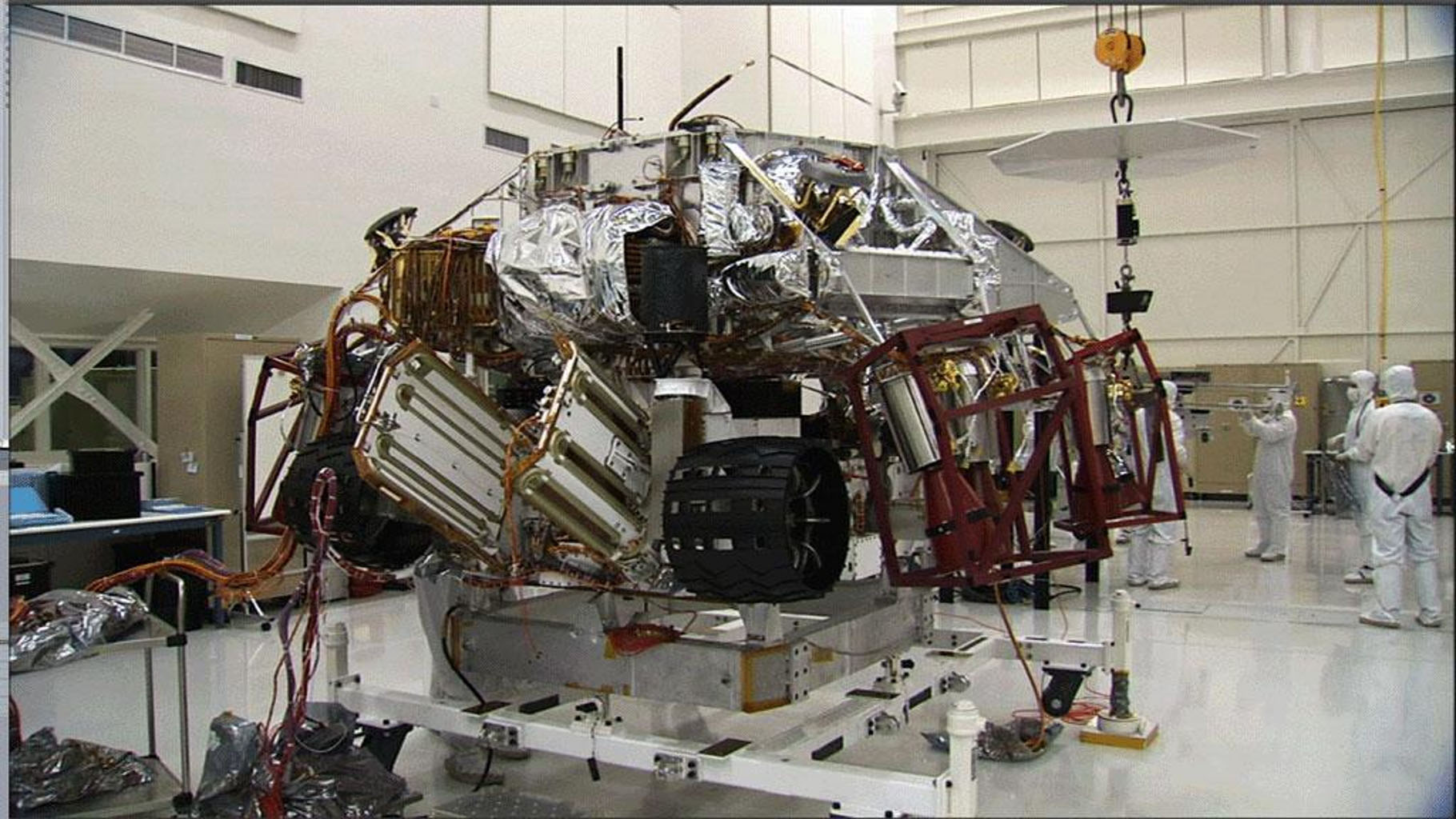 These three images show the progression of 'stacking' NASA's Mars Science Laboratory rover and its descent stage in one of NASA's Jet Propulsion Laboratory's 'clean room.'