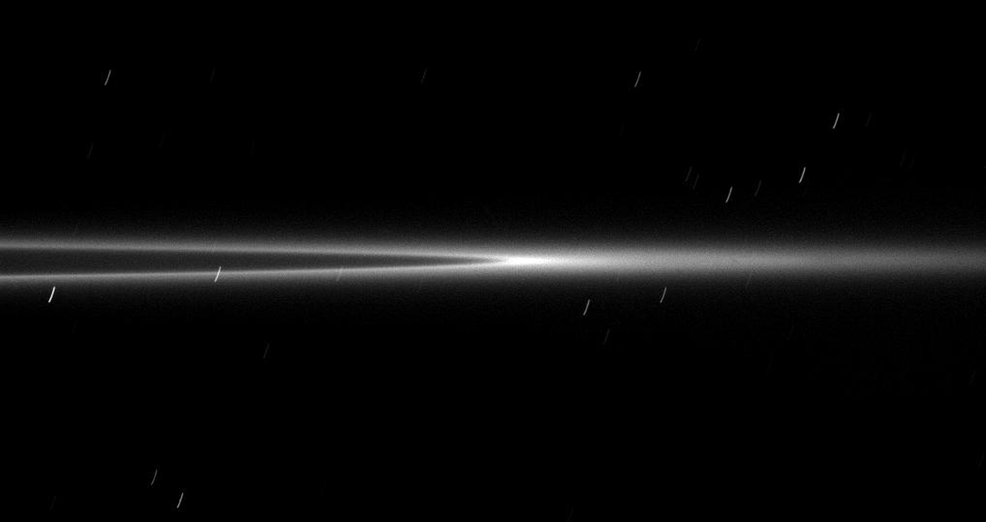 Seen from a viewpoint nearly coincident with the ringplane, the bright arc within the G ring appears even brighter with its ring material concentrated in the center of this image taken by NASA's Cassini spacecraft on Jan. 28, 2009.