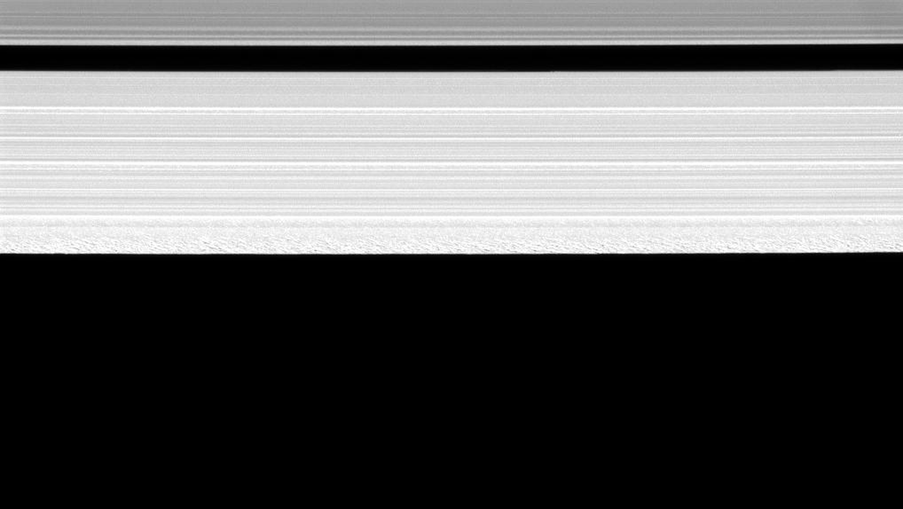 NASA's Cassini spacecraft reveals a remarkable amount of structure in the outer portion of Saturn's A ring in this image taken on June 2, 2008.