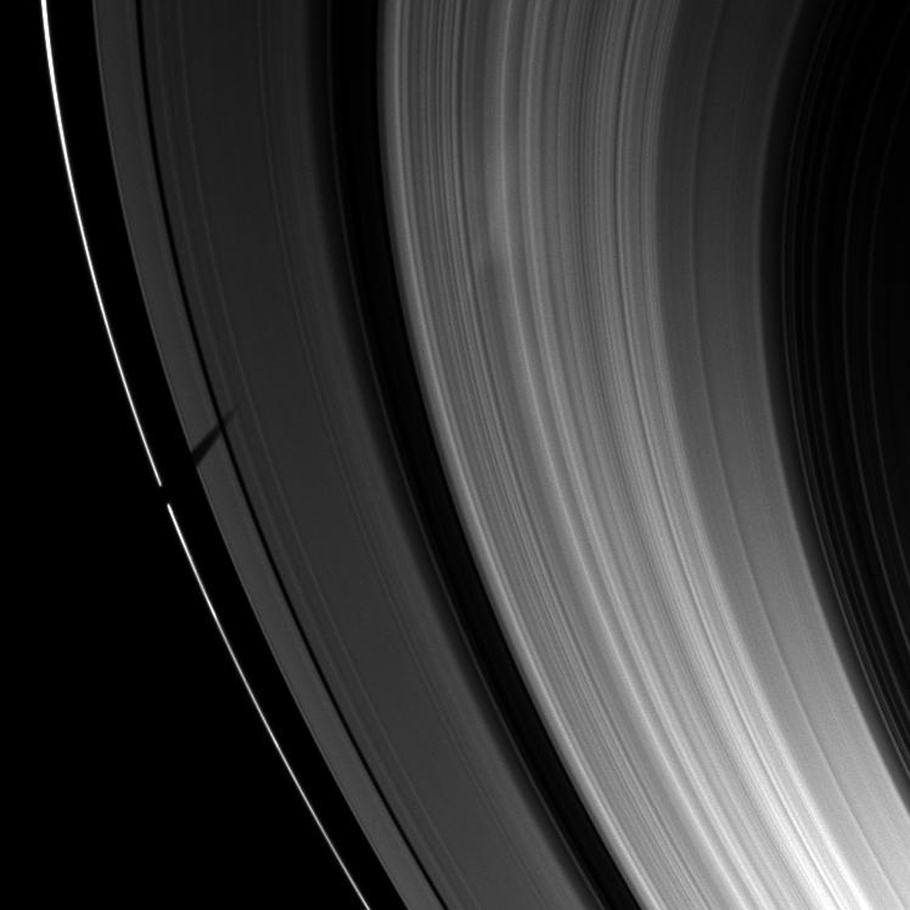 Saturn's moon Tethys casts a wide shadow over the planet's F and A rings. Tethys itself is not visible in this image taken by NASA's Cassini spacecraft taken on Apr. 21, 2009.