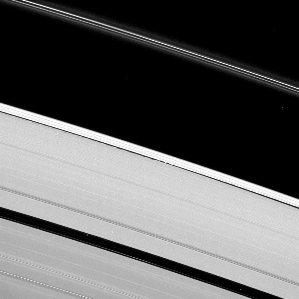 Saturn's moon Daphnis creates waves of disturbance in the Keeler Gap in this image of the wide A ring and narrow F ring in this image taken by NASA's Cassini spacecraft on Mar. 30, 2009.