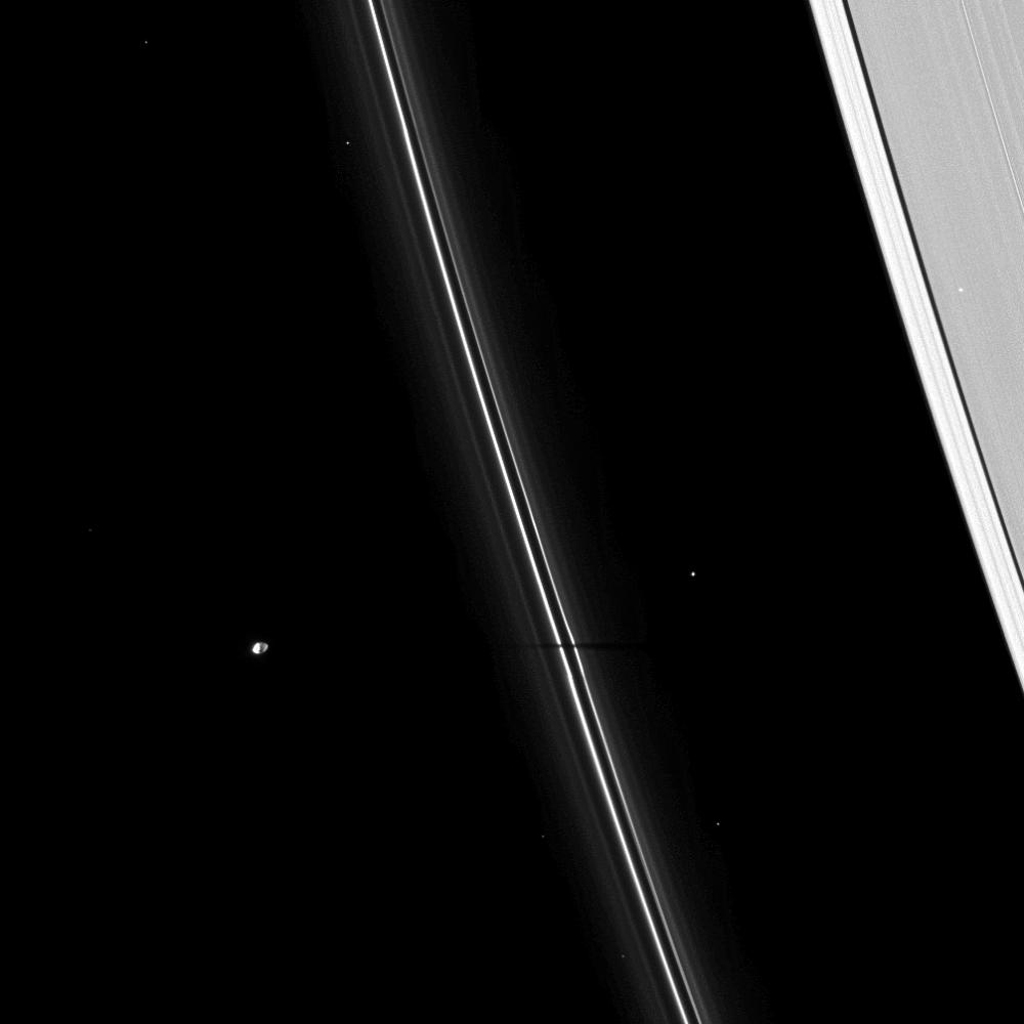 The thin shadow of the moon Pandora cuts across Saturn's narrow F ring, as seen by NASA's Cassini spacecraft on Apr. 16, 2009. As Saturn approaches its August 2009 equinox, the planet's moons cast shadows onto the rings.