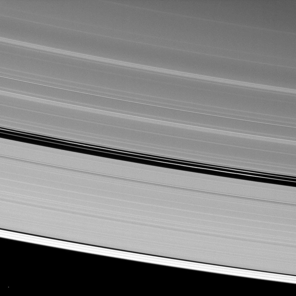 Although Saturn's moon Pan is absent from this image from NASA's Cassini spacecraft taken on Feb. 25, 2009 of the A ring's Encke Gap, two ringlets seen in the gap are maintained by Pan's gravitational action.