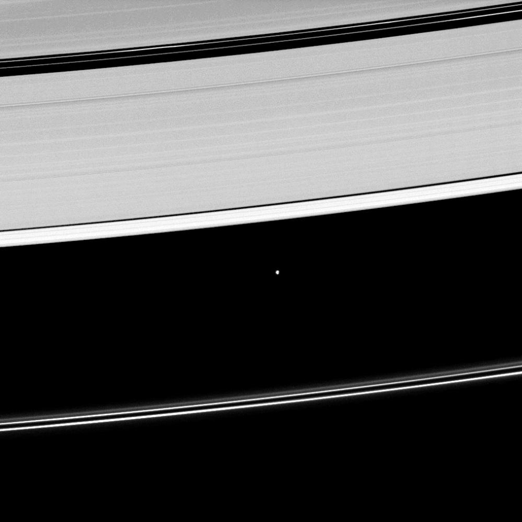 Saturn's moon Atlas, shown at the center of this image taken by NASA's Cassini spacecraft on May 2, 2009, orbits within the Roche Division separating the A ring from the tenuous F ring.