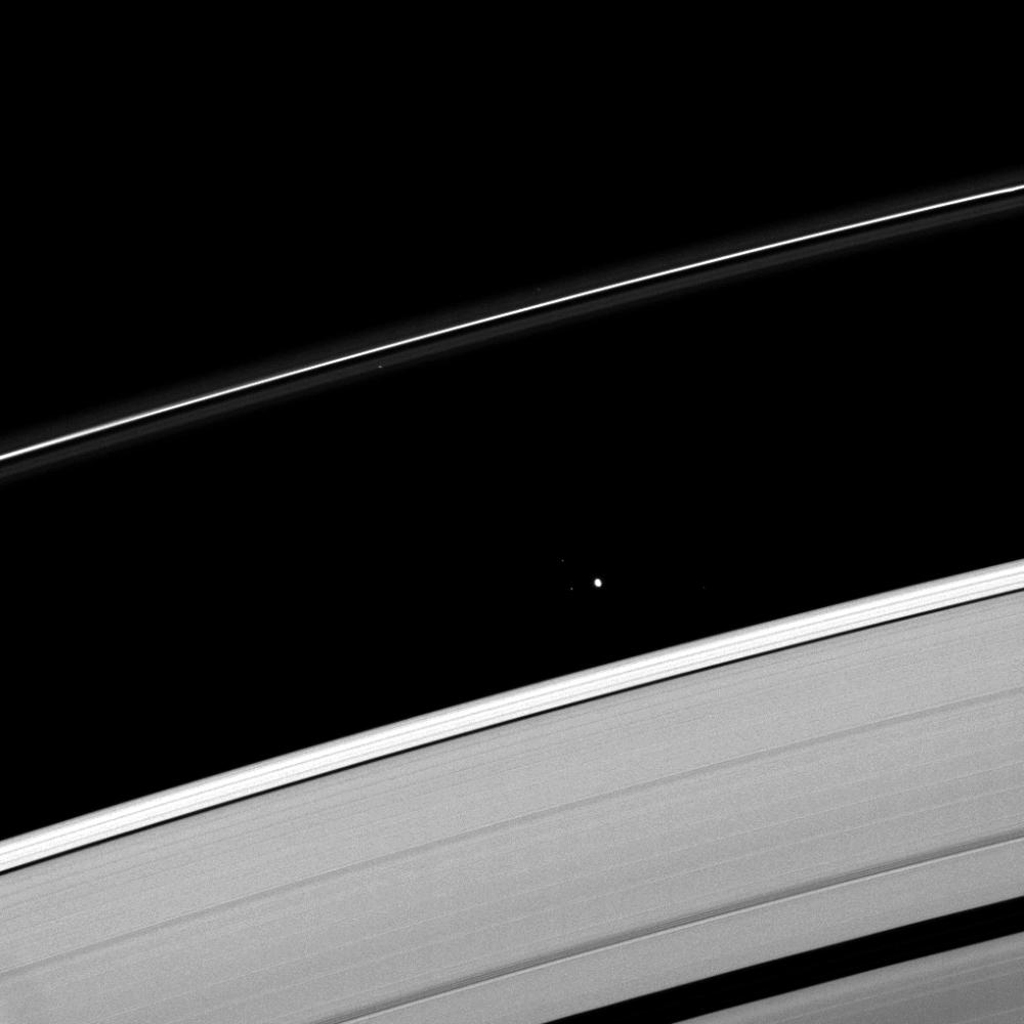 Saturn's moon Atlas plies the Roche Division between the A ring and the thin F ring. This image is from NASA's Cassini spacecraft.