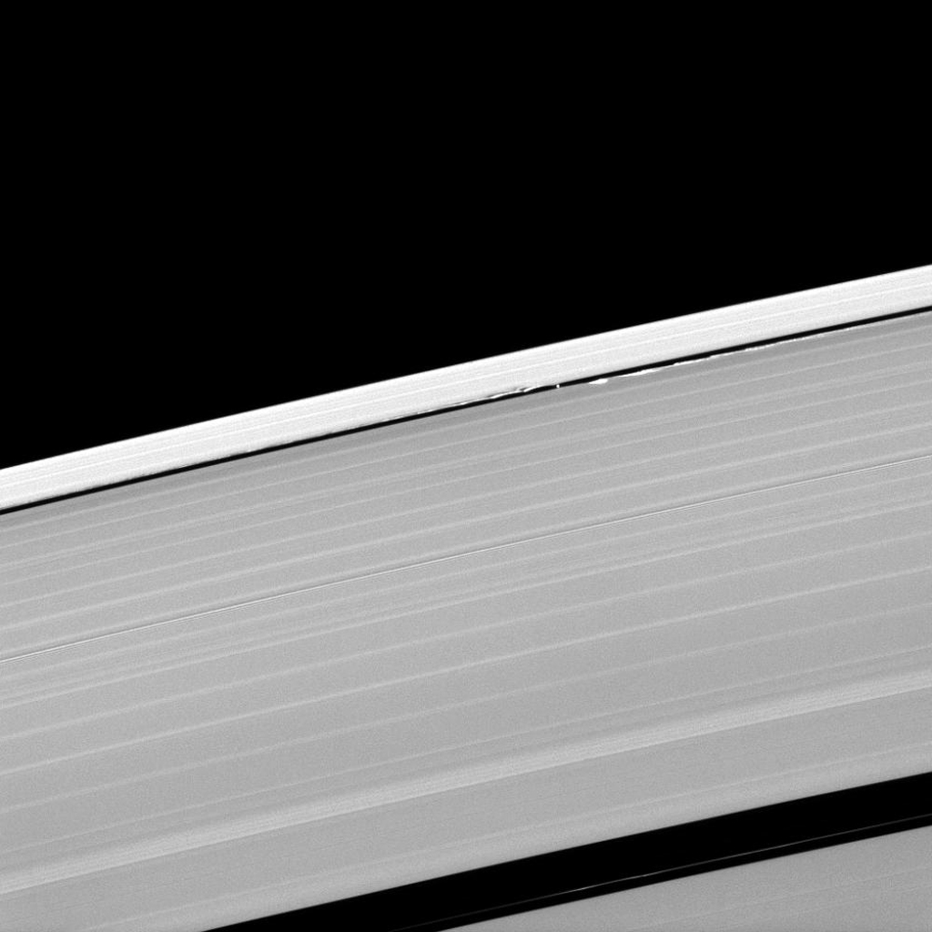 A scalloped look is created in the edges of the Keeler Gap in Saturn's outer A ring as the moon Daphnis orbits in the gap. This image is from NASA's Cassini spacecraft.