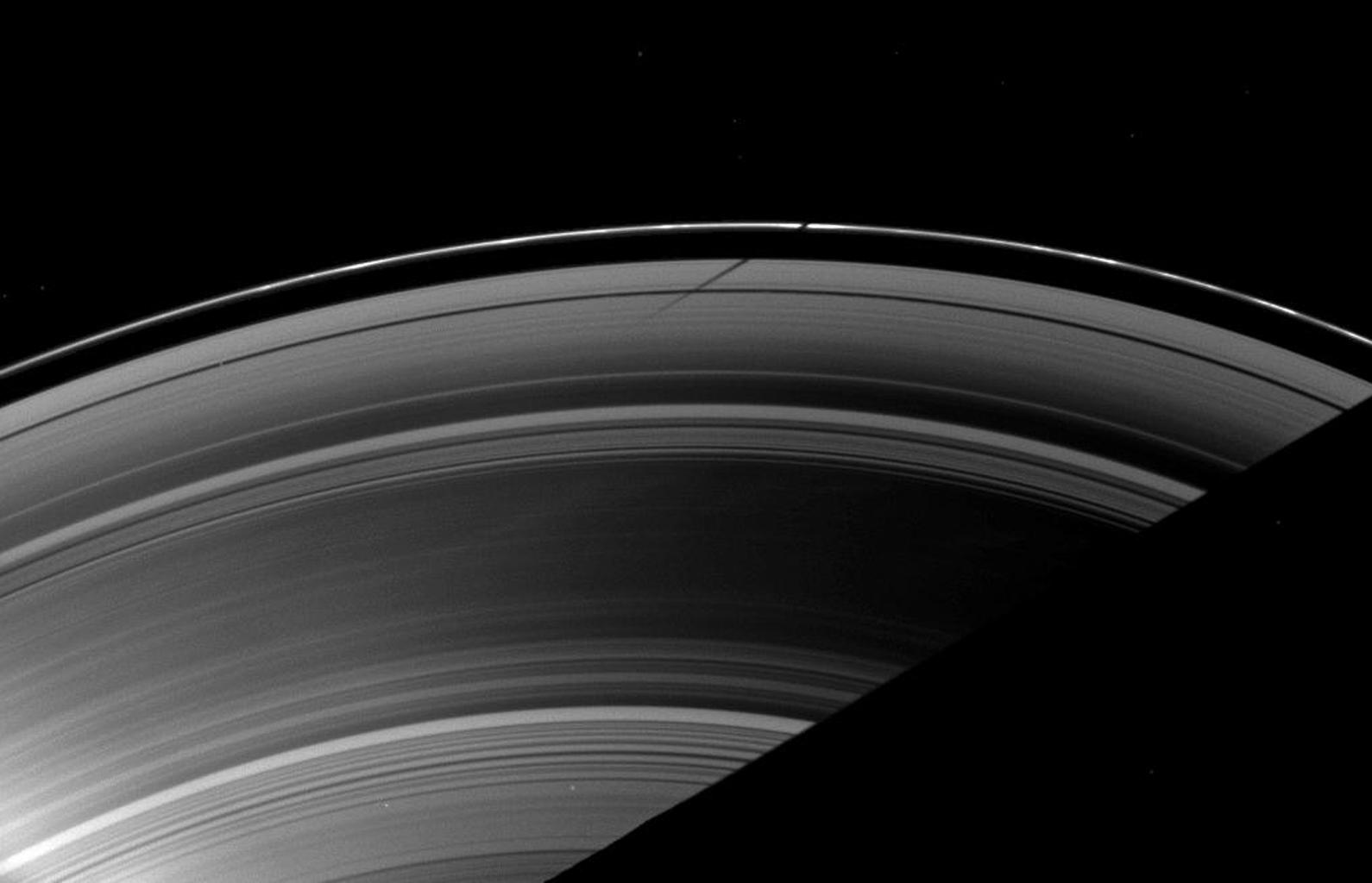 The shadow of the moon Mimas strikes the F ring at a different angle than the angle at which it is cast on the A ring, illustrating differences in the vertical heights of the rings in this image taken as Saturn approaches its August 2009 equinox.